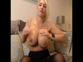 Hot blonde slut with big tits rides a thick cock on the couch
